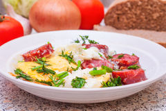 Scrambled eggs with sausage and vegetables Stock Photos