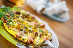 Scrambled eggs and sausages cauliflower with dill Stock Image