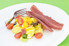 Scrambled Eggs Served With Two Slices of Fried Turkey Bacon Stock Photography