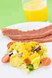 Scrambled Eggs Served With Two Slices of Fried Turkey Bacon Stock Image