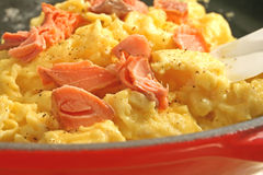 Scrambled Eggs and Smoked Salmon. Scrambled eggs with smoked salmon in red skillet Stock Images