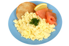Scrambled Eggs with Smoked Salmon. A DSLR royalty free image of, a healthy breakfast mean, scrambled eggs with some parsley also some salmon and lemon with a Royalty Free Stock Image