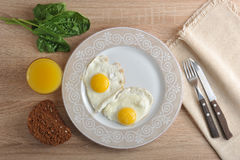 Scrambled eggs with spinach on the plate - a healthy Breakfast w Royalty Free Stock Photography