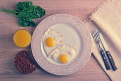 Scrambled eggs with spinach on the plate - a healthy Breakfast w Royalty Free Stock Photo