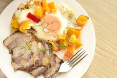 Scrambled eggs with sweet peppers, baked pork Stock Image