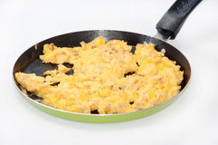 Scrambled eggs on teflon pan Stock Images