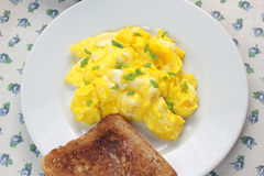 Scrambled eggs and toast. Royalty Free Stock Images