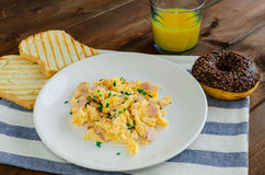 Scrambled eggs with toast and donut Royalty Free Stock Image