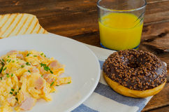 Scrambled eggs with toast and donut Royalty Free Stock Photography