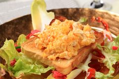 Scrambled eggs on toast and fresh salad Royalty Free Stock Photography