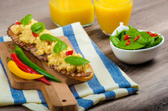 Scrambled eggs with toast and fresh salad Royalty Free Stock Images