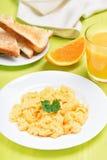 Scrambled eggs, toast and orange juice Royalty Free Stock Photography