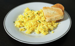 Scrambled eggs with toast Royalty Free Stock Photos