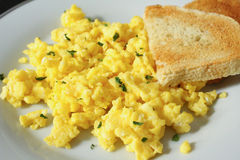 Scrambled eggs with toast Stock Photos