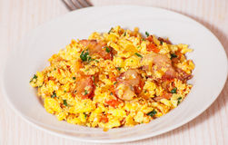 Scrambled eggs with tomato and bacon Stock Image