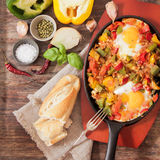 Scrambled eggs with tomato and peppers traditional breakfast. Scrambled eggs with tomato pepper traditional breakfast royalty free stock photography