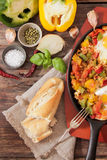 Scrambled eggs with tomato and peppers traditional breakfast. Scrambled eggs with tomato pepper traditional breakfast royalty free stock photos