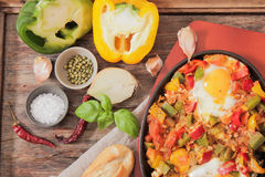 Scrambled eggs with tomato and peppers traditional breakfast. Scrambled eggs with tomato pepper traditional breakfast bread and salt stock image
