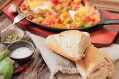 Scrambled eggs with tomato and peppers traditional breakfast. Scrambled eggs with tomato pepper traditional breakfast bread and salt stock photography