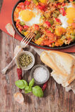 Scrambled eggs with tomato and peppers traditional breakfast. Scrambled eggs with tomato pepper traditional breakfast bread and salt stock photos