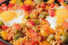 Scrambled eggs with tomato and peppers traditional breakfast. Scrambled eggs with tomato pepper traditional breakfast bread and salt royalty free stock photography