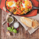 Scrambled eggs with tomato and peppers traditional breakfast. Scrambled eggs with tomato pepper traditional breakfast bread and salt stock images