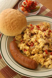 Scrambled eggs with tomato and sausage Stock Images