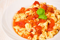 Scrambled eggs with tomato Stock Photography