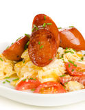 Scrambled eggs with tomatoes and chorizo sausage on white backgr Stock Photo