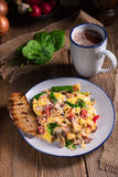 Scrambled eggs with tomatoes and spinach Royalty Free Stock Photography