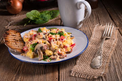 Scrambled eggs with tomatoes and spinach Royalty Free Stock Image