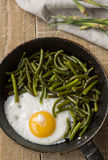 Scrambled eggs. With vegetables in a pan Royalty Free Stock Photography