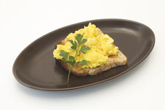 Scrambled eggs on a white background Stock Photos