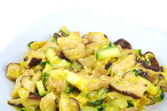Scrambled eggs with zucchini and shitake mushroom. royalty free stock photography