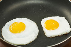 Scrambled fried eggs, classic cooking Royalty Free Stock Images