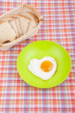 Scrambled in a heart shape on a plate. Royalty Free Stock Photos