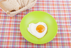 Scrambled in a heart shape on a plate. Stock Images