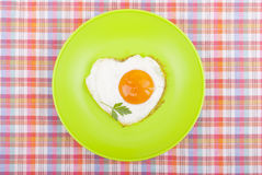 Scrambled in a heart shape on a plate. Royalty Free Stock Photo