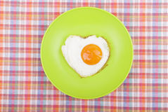 Scrambled in a heart shape on a plate. Royalty Free Stock Photography