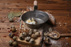 Scrambled quail eggs. Scrambled eggs with black bread on a wooden background royalty free stock image