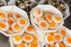 Scrambled quail eggs and boiled eggs at market Stock Photography
