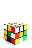 Scrambled rubik's cube. In a vertical white background Stock Image