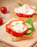 Scrambled in sweet pepper on toast Royalty Free Stock Photo