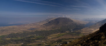 Scenic view over mountains and sea on sunny day. Top view of mountain in Ireland and sea or ocean with blue sky royalty free stock images