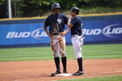 Scranton Wilkes Barre Yankees Justin Maxwell. Talks with his coach Stock Image