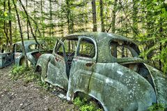 Scrap car  in the  woods Royalty Free Stock Photo