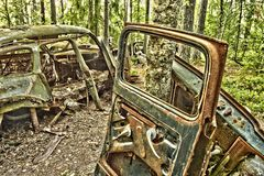 Scrap car  in the  woods Royalty Free Stock Photography