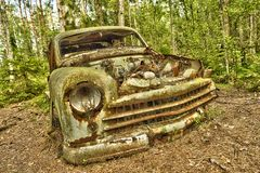 Scrap car  in the  woods. Scrap car  in the woods Royalty Free Stock Images