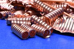Scrap of copper for recycling on blue background. Copy space royalty free stock image