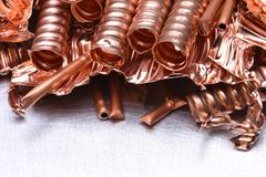 Scrap of copper for recycling on metal background. Copy space royalty free stock image